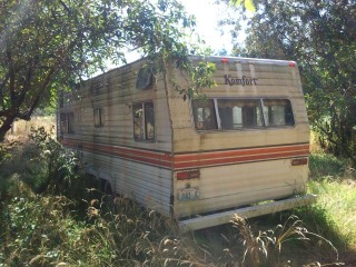 Busby junk removal hauls old vehicles including campers and trailers